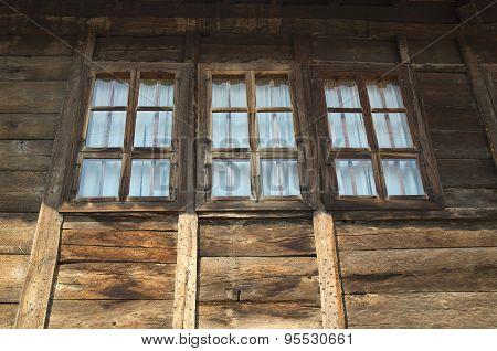 Stylish windows on wooden house