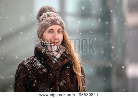 Young woman with a bobble cap
