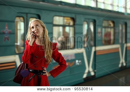 Young woman with mobile phone in underground