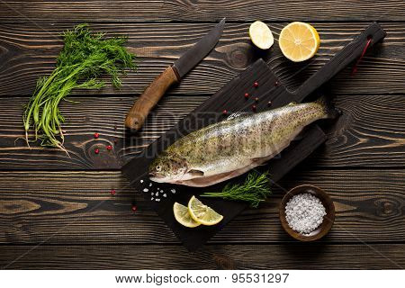 Fresh Whole Trout Fishes On Cutting Board Top View
