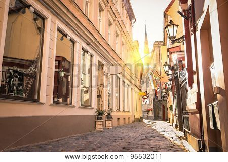 Vintage Retro Travel Image Of A Narrow Medieval Street In Old Town Riga At Sunset - Latvia - Europe