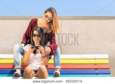 Best Friends Enjoying Time Together Outdoors With Smartphone - Concept Of New Technology