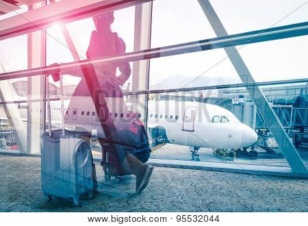 Travel Concept With Woman And Suitcase Moving Fast To Airport Terminal Gate - Double Exposure Look