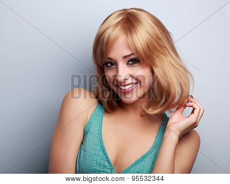 Beautiful Happy Young Woman With Blond Short Bob Hair Style. Closeup Portrait