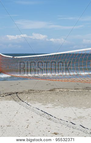 Empty Beach With Valleyball Net Across