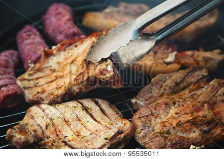 Steaks on barbecue closeup