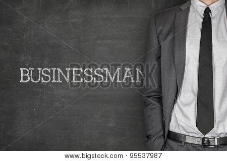 Businessman on blackboard