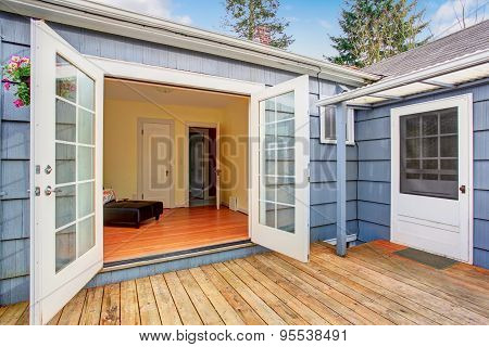 Elegant White Glass Doors Leading To Back Deck.