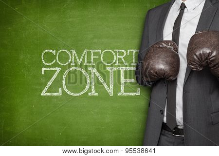 Comfort zone on blackboard with businessman