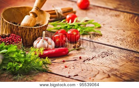 Spices and ingredients on wood background