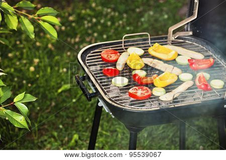 Cooking vegetables on grill barbecue on nature