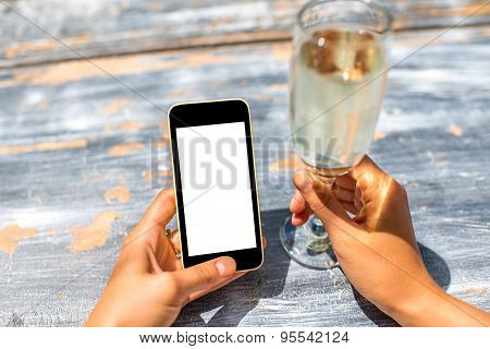 Using phone on wooden table background