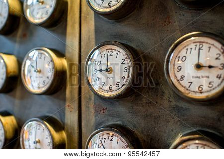 Metal wall with old styled clocks