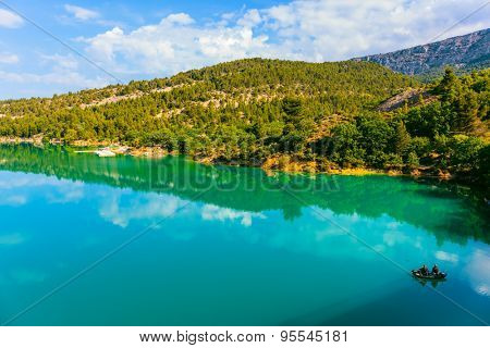 Spring Provence. Azure water mirror reflecting clouds. The biggest mountain canyon in the French Alps - Verdon