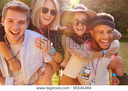Men Giving Woman Piggybacks On Their Way To Music Festival