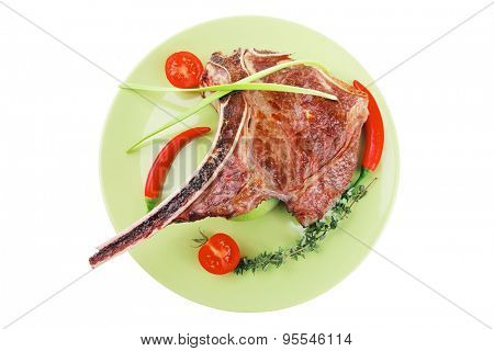 meat food : roast rib on green dish with thyme pepper and tomato isolated over white background