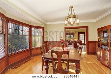 Well Put Together Dinning Room With Hardwood Floor.