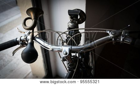 Handlebar With Golden Horn Like A Trumpet And Acetylene Headlight Of A Vintage Moped