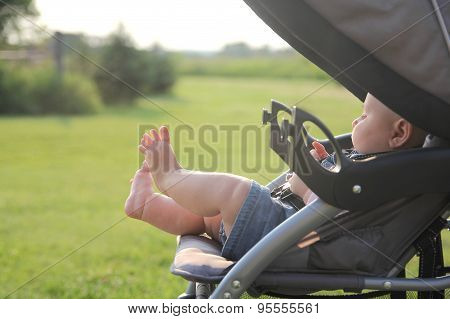 Newborn Baby Legs And Feet Hanging Out Of Stroller