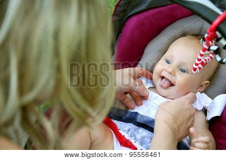 Laughing Newborn Baby Girl In Car Seat