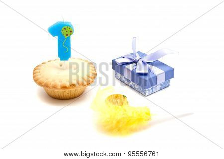 Cupcake With One Years Birthday Candle, Gift And Whistle On White