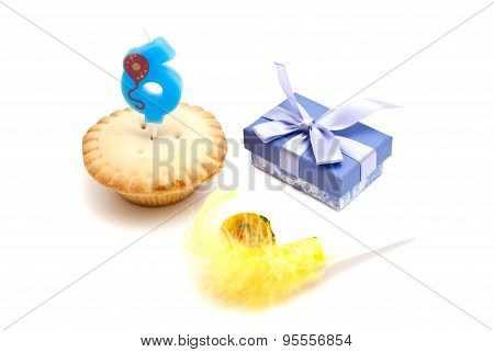 Cupcake With Six Years Birthday Candle, Gift And Whistle On White