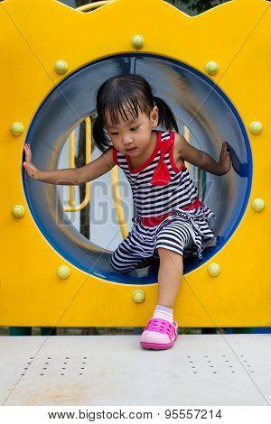 Asian Kid Crawling On Playground Tube