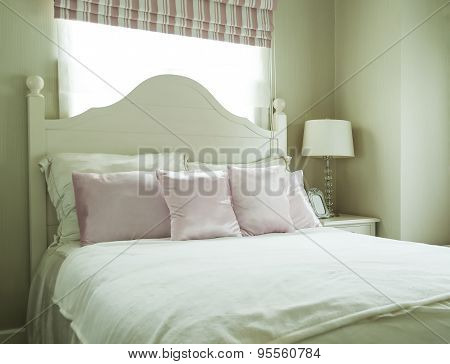 Concept For Luxury Bedroom With Pillows And Desk Lamp