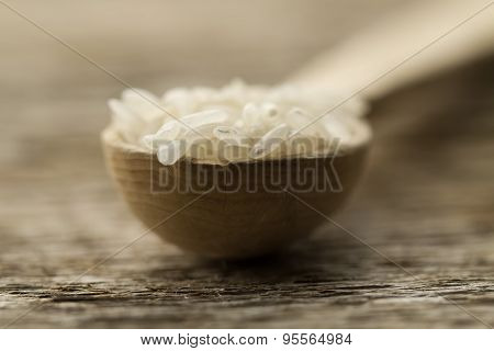 Long Grain Rice In A Wooden Spoon On The Table. Healthy Eating, Diet, Vegetarianism.