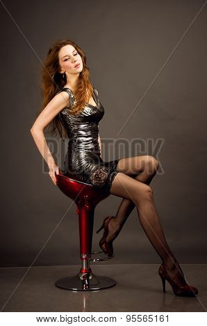 Studio full length portrait of a young sensual attractive slim woman