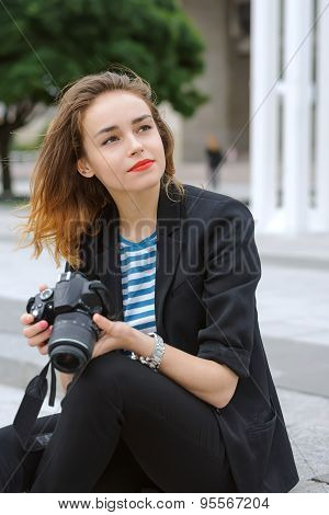 Woman Photographer Sits On The Steps