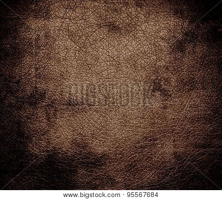 Grunge background of dark brown-tangelo leather texture