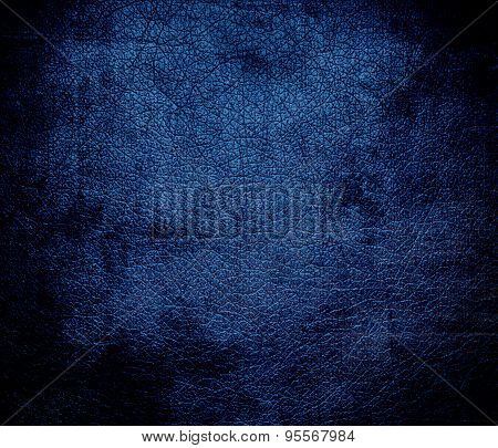 Grunge background of dark cerulean leather texture