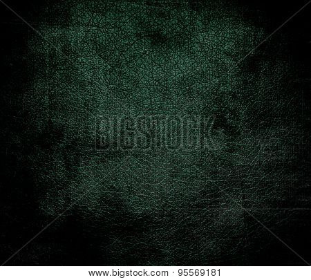 Grunge background of dark green leather texture