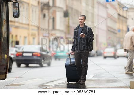 Young Traveler Waiting For Bus