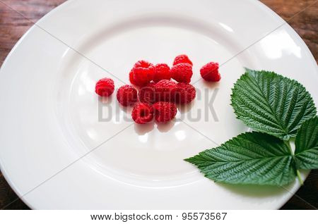 Raspberry Berries On A White Plate