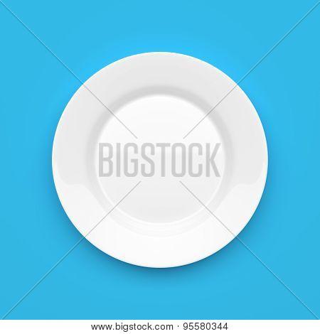 Empty White Ceramic Round Plate On Blue