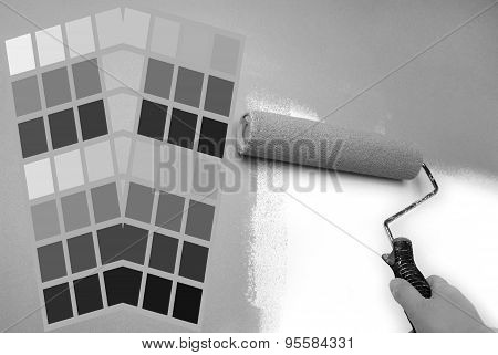grey color chart and hand painting wall