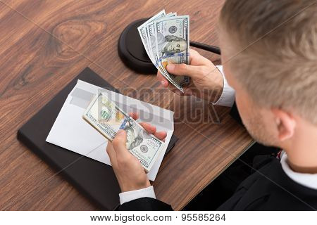 Judge Counting Money In Courtroom