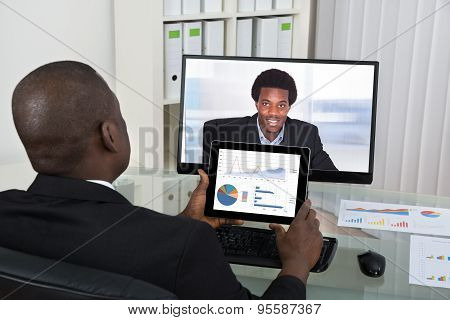 Businessman Video Chatting With Colleague On Computer