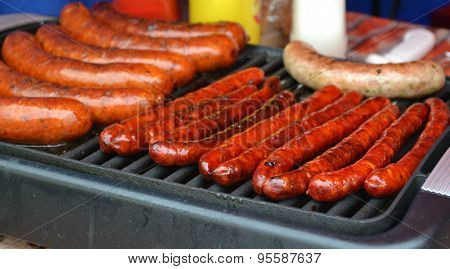Sausages grilled on a barbecue