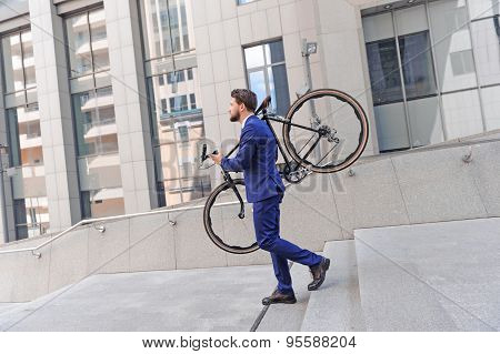 Nice man holding bicycle