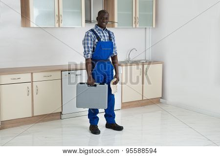 Young Technician Holding Toolbox