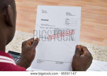 Man Holding Invoice With Final Demand Notification