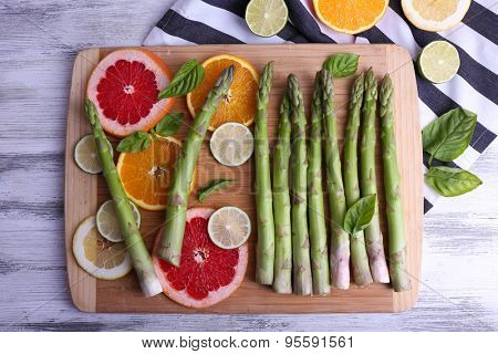 Fresh asparagus on wooden cutting board, close-up