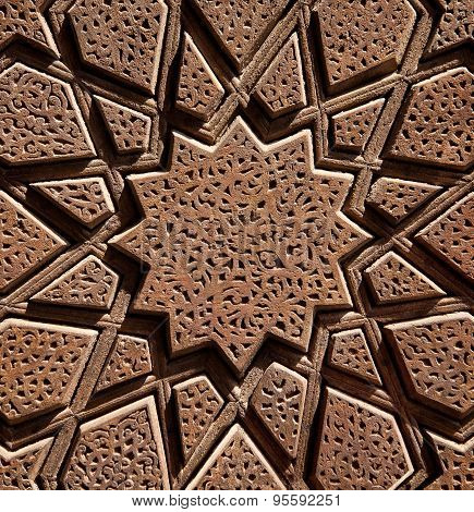 Islamic Wooden Star Shaped Design Carved On Brown Wood