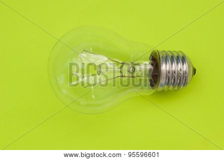 Light Bulb On A Green Background
