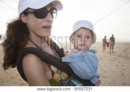 Mom And Baby In Rucksack At Beach