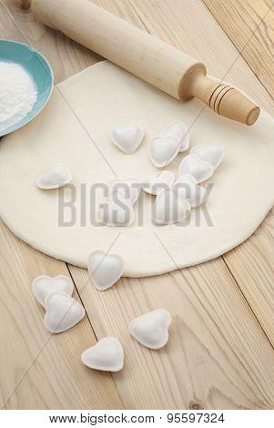 Dumplings In A Heart Shape Dough And Rolling Pin.