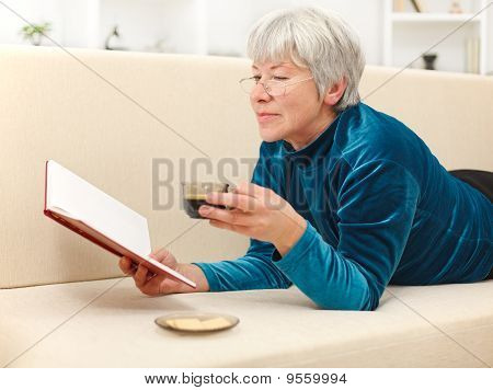Senior Woman With Book And Coffee